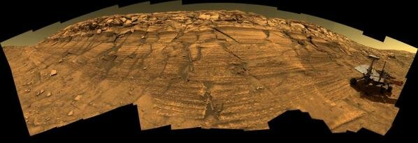 """Mars Exploration Rovers: This special-effects image combines a model of the Mars rover Opportunity and 46 photogrpahs that Opportunity took of """"Burns cliffs"""" near the edge of """"Endurance Crater"""". Image courtesy of NASA/JPL-Caltech/Cornell."""